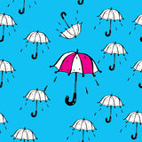 Umbrellas and rain drops vector seamless pattern Stock Images