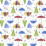 Umbrellas and rain drops on white background Stock Photos