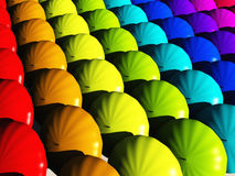 Umbrellas in rainbow hues Stock Photos