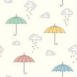 Umbrellas and rainy clouds background Stock Photos