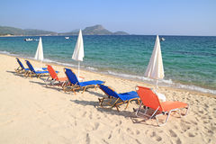 Umbrellas and recliners by the sea Stock Image