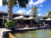 Umbrellas on a Restaurant Patio, Miami Florida. The beautiful tropical scenery and water feature outside at Matthew Kenney& x27;s plant based restaurant, Plant royalty free stock photos