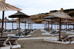 Umbrellas on sandy beach Stock Images