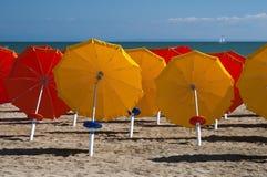 Umbrellas on Sandy Beach Royalty Free Stock Photos