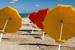 Umbrellas on Sandy Beach Stock Images