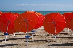Umbrellas on Sandy Beach Royalty Free Stock Photography