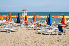 Umbrellas on Sandy Beach. Colorful umbrellas on sandy beach in Lignano Sabbiadoro, Italy, Europe royalty free stock images