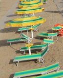 Umbrellas in sandy beach seen from above in summer Stock Photos
