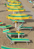 Umbrellas in sandy beach seen from above in summer Stock Images