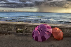 Umbrellas by the sea Royalty Free Stock Image