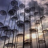 Umbrellas in the sky. Beatiful art in a small Greek town Stock Photography