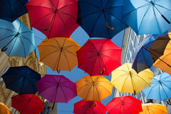 Umbrellas. In the sky of the city Stock Image