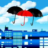 Umbrellas in the sky. With clouds and buildings Royalty Free Stock Photography