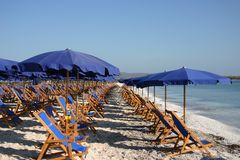 Umbrellas in a solitary beach Royalty Free Stock Images