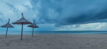 Umbrellas on the storm stock photos