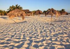 Umbrellas of straw. Playa Sirena. Cayo Largo. Cuba Royalty Free Stock Photos