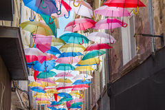 Umbrellas in a street of Avignon, France Royalty Free Stock Photography