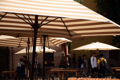 Umbrellas in street cafe-bar background Royalty Free Stock Photography