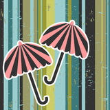 Umbrellas on stripey background Royalty Free Stock Photography