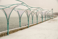 Umbrellas summer cafe on a snowy embankment in Pomorie, Bulgaria royalty free stock images