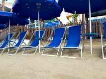 Beach umbrellas at the beach. Umbrellas on the summer sandy beach in the sun Stock Images