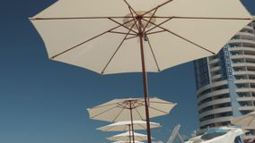 Umbrellas from the sun on the beach. The concept of summer vacation, tourism. Relaxation.UV protection stock video