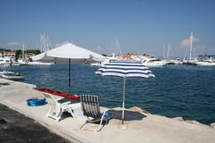 Umbrellas and sun beds by the Adriatic Sea, Croatia stock images