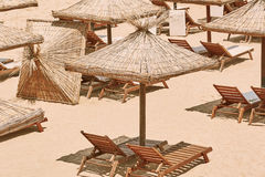 Umbrellas and Sun Loungers. On the Beach stock image