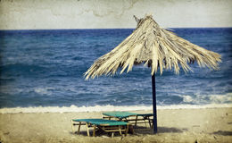 Umbrellas and sunbeds on the beach Stock Photography
