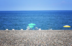 Umbrellas and Sunbeds on the beach Royalty Free Stock Photo