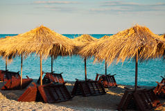 Umbrellas and sunbeds on the beach Royalty Free Stock Photos