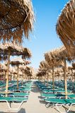 Umbrellas and sunbeds on Elafonissi beach, Crete, Greece Royalty Free Stock Photo