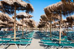 Umbrellas and sunbeds on Elafonissi beach, Crete, Greece Royalty Free Stock Photos