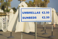 Umbrellas and sunbeds for hire Stock Image
