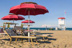 Umbrellas and sunbeds - Rimini Beach - Italy Stock Photo