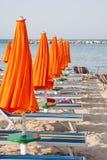 Umbrellas and sunbeds in Rimini and Riccione and Cattolica Beach Stock Photo