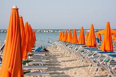 Umbrellas and sunbeds in Rimini and Riccione and Cattolica Beach Royalty Free Stock Photography