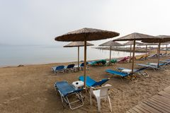 Umbrellas and sunbeds on the sea beach, early morning photo stock photos