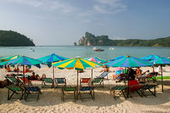 Umbrellas and sunchairs at Ao Loh Dalum beach on Phi Phi Don Isla. Nd, Krabi Province, Thailand. Koh Phi Phi Don is part of a marine national park Stock Photography