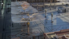 Umbrellas time lapse with splits screen. Nabawi Mosque Umbrellas time lapse with splits screen stock video