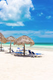 Umbrellas at a tropical beach in Cuba Royalty Free Stock Photography