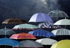 Umbrellas under raindrops stock photography