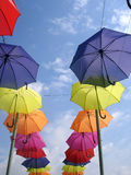 Umbrellas up!. These are umbrellas which are hung up on a bridge Stock Photography