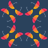 Umbrellas of various colors on blue background Stock Photos