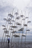 Umbrellas in the waterfront of Thessaloniki, Greece, under a cloudy sky Stock Photography