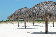 Umbrellas on the white sandy beach. In Cuba royalty free stock photo