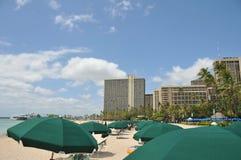 Umbrells cover Waikiki Beach near hotels Stock Photo