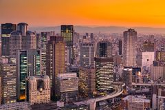 Umeda Osaka city central business downtown, Japan cityscape. With mountain background Royalty Free Stock Image
