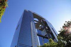 Umeda Sky Building-skyscraper and landmark in Osaka. Umeda Sky Building, Osaka, Japan. View of the building from the bottom up. May 5, 2017 Stock Photography