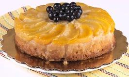 Umgedrehter Kuchen des Pfirsiches Stockfotos